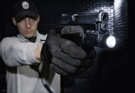 Police officer demonstrating protective gloves in marketing photo shoot